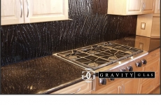 Black-sweep-texture-set-on-granite-counter-top