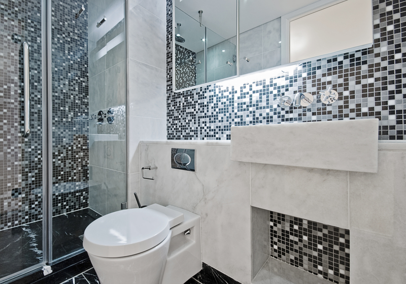 Grid-Style Metal Cladded Shower Doors - House of Mirrors and Glass - Mirrors and Glass in Calgary