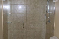 frameless_inline_shower_with_glass_corner_shelves