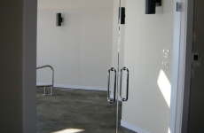 Frameless glass doors for pool entrance