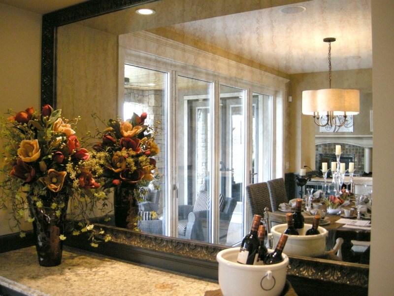 Framed_antique_mirror_in_dining_room
