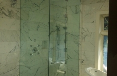 Frameless steam shower door with fixed transom