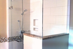 Glass shower door with pony wall