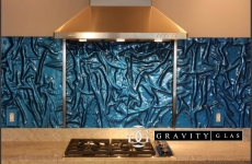 AZURE-Blue-Linen-Backsplash-with-stainless-dividers-over-cooktop-Close-up